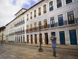 Local Man Selling Savoury Cakes in Old Historic Centre of Sao Luis Photographic Print by Viviane Ponti