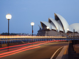 Light Trailing under Harbour Bridge with Sydney Opera House Beyond Photographic Print by Andrew Watson