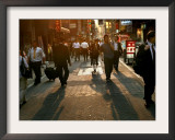 Japanese Commuters Walk Through a Tokyo Street on Their Way to the Train Stations Framed Photographic Print by David Guttenfelder