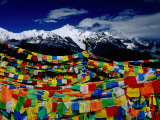 Meilixueshan (Also known as Meili Xueshan) Mountain Range and Buddhist Prayer Flags Photographic Print by Richard l'Anson
