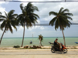 Motorcyclist Driving by Northern Coast of Ko Samui Photographic Print by Austin Bush