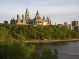The Buildings of Parliament Hill, Along the Ottawa River Photographic Print by Sean Caffrey