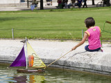 Girl with Toy Boat in Pond of Jardin Des Tuileres Photographic Print by Lou Jones