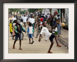 Children Play Soccer on a Monrovian Street Framed Photographic Print