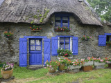 Thatched Cottage with Blue Doors, Windows and Pots of Geraniums Near Marzan Photographie par Barbara Van Zanten