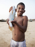 Boy Showing Off Fish Photographic Print by April Maciborka