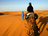 Traveller Riding Camel at Erg Chebbi Photographic Print by Brian Cruickshank