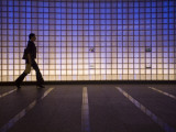 Pedestrian in a Neon-Lit Passageway in Namba Station Photographic Print by Brent Winebrenner