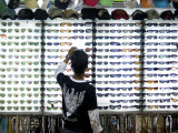 Customer at Sunglass Stall at Kata Beach Evening Market Photographic Print by Austin Bush