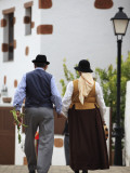 Man and Woman in Traditional Costumes Leaving Main Street During Festival of San Lucia Photographic Print by Ruth Eastham & Max Paoli