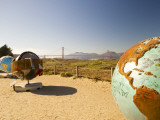 Globe Sculptures Along Footpath Photographic Print by Thomas Winz