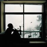 Man Smoking Water Pipe by Window, Alborz Mountain Range Fotodruck von Christian Aslund