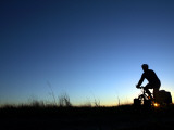Man Cycle Touring at Dawn Photographic Print by Andrew Bain