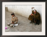 A Young Afghan Vendor Sells Toilet Paper at a Mosque Framed Photographic Print by Rodrigo Abd