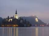 Baroque Church of Assumption on Bled Island with Renaissance Bled Castle Photographic Print by Richard Nebesky