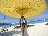 Man Putting Up Umbrella on Kamala Beach Photographic Print by Austin Bush