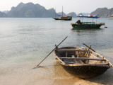 Woven Sampan Beached on Sand with Halong Bay and Boats in Background Photographic Print by Sally Dillon