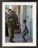 Israeli Soldier Tells a Palestinian Boy to Leave the Scene Following a Knife Attack Framed Photographic Print