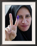 Iraqi Woman Holds Up Her Purple Finger, Indicating She Has Just Voted in Southern Iraq Framed Photographic Print