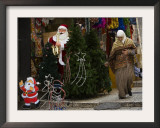 Palestinian Woman Walks Past Christmas Decorations at a Shop in Jerusalem's Old City Framed Photographic Print