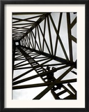 A Reenactor is Silhouetted Inside a Replica of the Spindletop Oil Derrick Framed Photographic Print