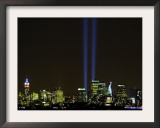 Two Beams of Light Light up the Sky Above Manhattan Framed Photographic Print