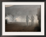 An Unidentified Couple Walk Hand-In-Hand Framed Photographic Print