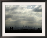 People and a Dog are Silhouetted Against a Landscape of Central London Framed Photographic Print
