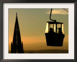A Couple Sit in a Cable Car Gondola Framed Photographic Print