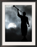 Statue is Seen Against a Cloudy Sky and a Partial Solar Eclipse in Bogota, Colombia Framed Photographic Print