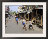 Children Play Soccer on One of the Streets of the Business District of Lagos Framed Photographic Print