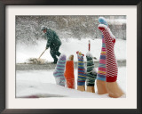 Shoveling Snow from a Sidewalk Near a Winter Stockings Sale Display in Downtown Warsaw, Poland Framed Photographic Print