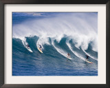 Surfers Ride a Wave at Waimea Beach on the North Shore of Oahu, Hawaii Framed Photographic Print
