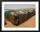 Two Sudanese Boys Stand by Makeshift Huts Framed Photographic Print