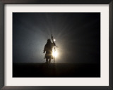 Performer is Silhouetted at the Opening Ceremonies for the XXI Olympic Winter Games in Vancouver Framed Photographic Print