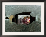 An Iraqi Woman with a Child Peers Through a Shattered Window of a Destroyed Car Framed Photographic Print