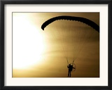 An Engine-Powered Paraglider Soars Through the Air Near Schlesen Framed Photographic Print