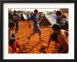 Children Play Soccer Between Tents Placed on a Dusty Lot Framed Photographic Print