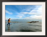 A Man Walks on the Ice-Covered Southeastern Macedonian Dojran Lake Framed Photographic Print
