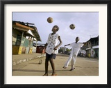 Children Play Soccer on a Street Framed Photographic Print