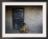 Afghan Refugee Youth Sits on the Ground Holding a Baby in Front of a Shop in Pakistan Framed Photographic Print