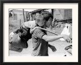 A South Vietnamese Father Carries His Son and a Bag of Household Possessions Framed Photographic Print