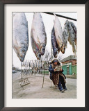 A Woman Selling Dried Fish Waits for Customers on the Outskirts of Rostov-On-Don Framed Photographic Print