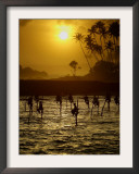 Sri Lankan Fishermen Sit Perched on Stilts Fixed into the Ocean Floor Framed Photographic Print