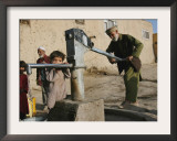 An Elderly Man Pumps Water from a Public Well in Kabul, Afghanistan, Friday, September 22, 2006 Framed Photographic Print by Rodrigo Abd
