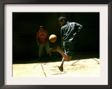 An Egyptian Boy Shows off His Ball Skill as He Plays Soccer with a Friend on the Steets of Cairo Framed Photographic Print