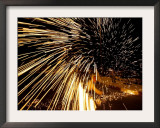 A Palestinian Boy Plays with a Homemade Sparkler Framed Photographic Print by Muhammed Muheisen