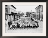 German School Teachers and Children Wear Gas Masks as They are Drilled Framed Photographic Print