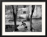 A Young Afghan Girl Carries Water from a Well to Her Family Framed Photographic Print