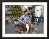 A Vietnamese Vendor Races Down a Street on a Motorbike Carrying a Kumquat Tree for Sale Framed Photographic Print